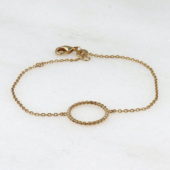 Women's twisted ring bracelet on a gold-plated chain