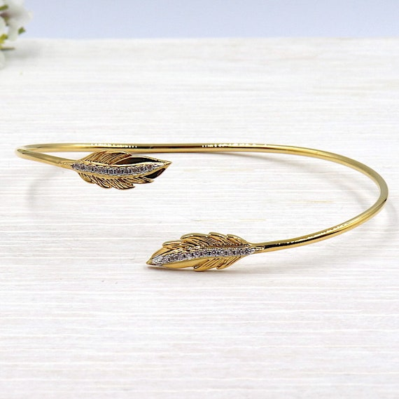 Feather and 750 thousandth 3 Micron gold plated zircon Bangle Bracelet
