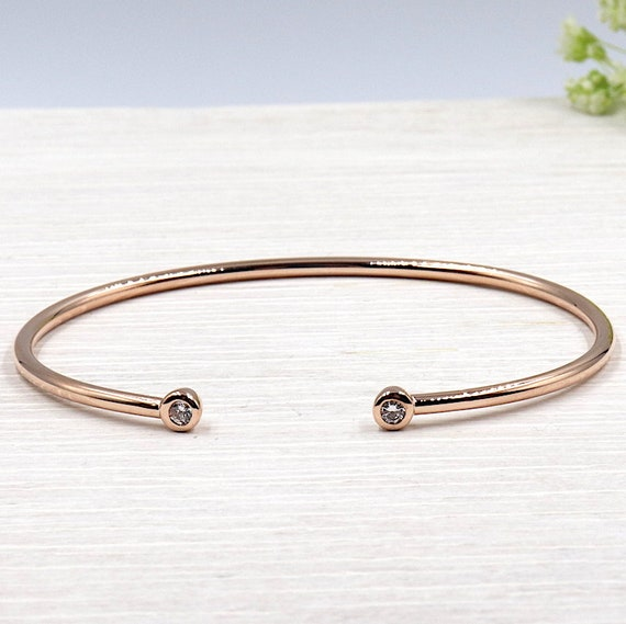 Bangle is plated rose gold 3 microns and zircon