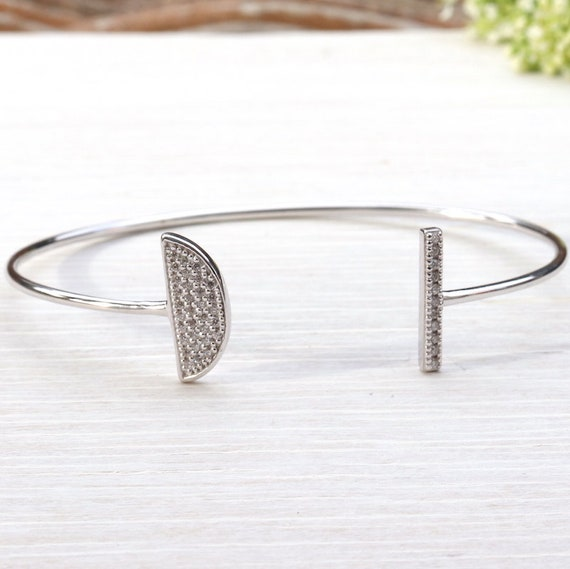Bangle is half moon Sterling Silver 925 and zircons
