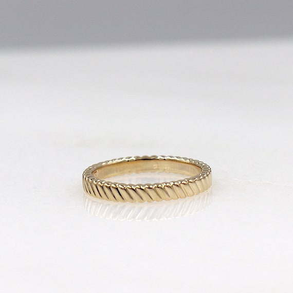 woman's gold-plated ring streaked