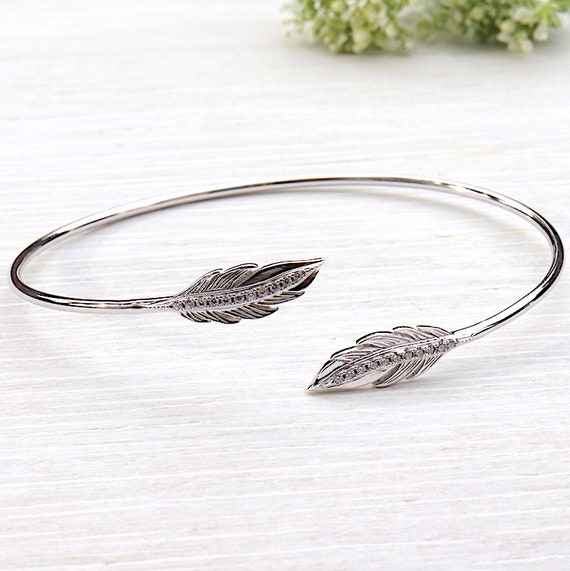 silver rush bracelet 925 feather and zincons