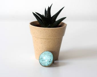 Unique bronze cameo ring with a blue brick pattern