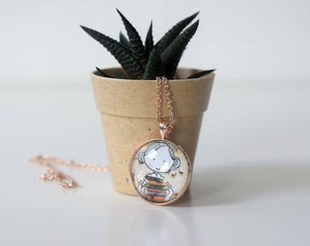 Rose gold cameo necklace with an image of a bookloving girl