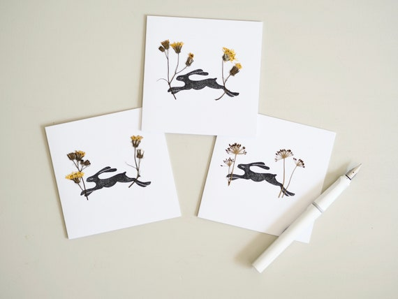 A set of three Lino Printed Snowdrop Gift Cards.