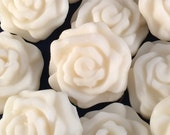 Rose shape soy wax melts. 3.75 oz. beautiful colors in many fragrances. Melts for tea light or electric wax warmer.