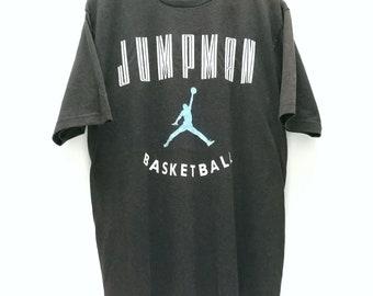 253782e8 Super Rare! Vintage 90s JORDAN BRAND by Michael Jordan JUMPMAN Basketball t  shirt size L