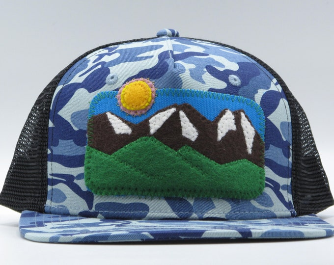 Three Sisters Mountains Blue Camouflage Flat Bill Trucker Hat