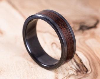 Fire-blackened titanium and Rosewood ring. Engagement ring, wedding ring. Men ring.