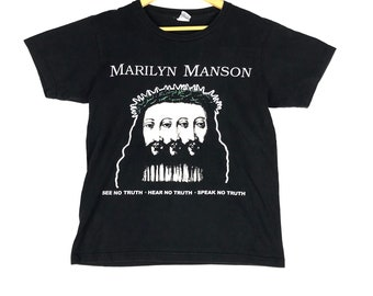 c37b3a70990f86 vintage 90s marilyn manson beLIEve album tour singles spell out big image  american rock band promo t-shirts