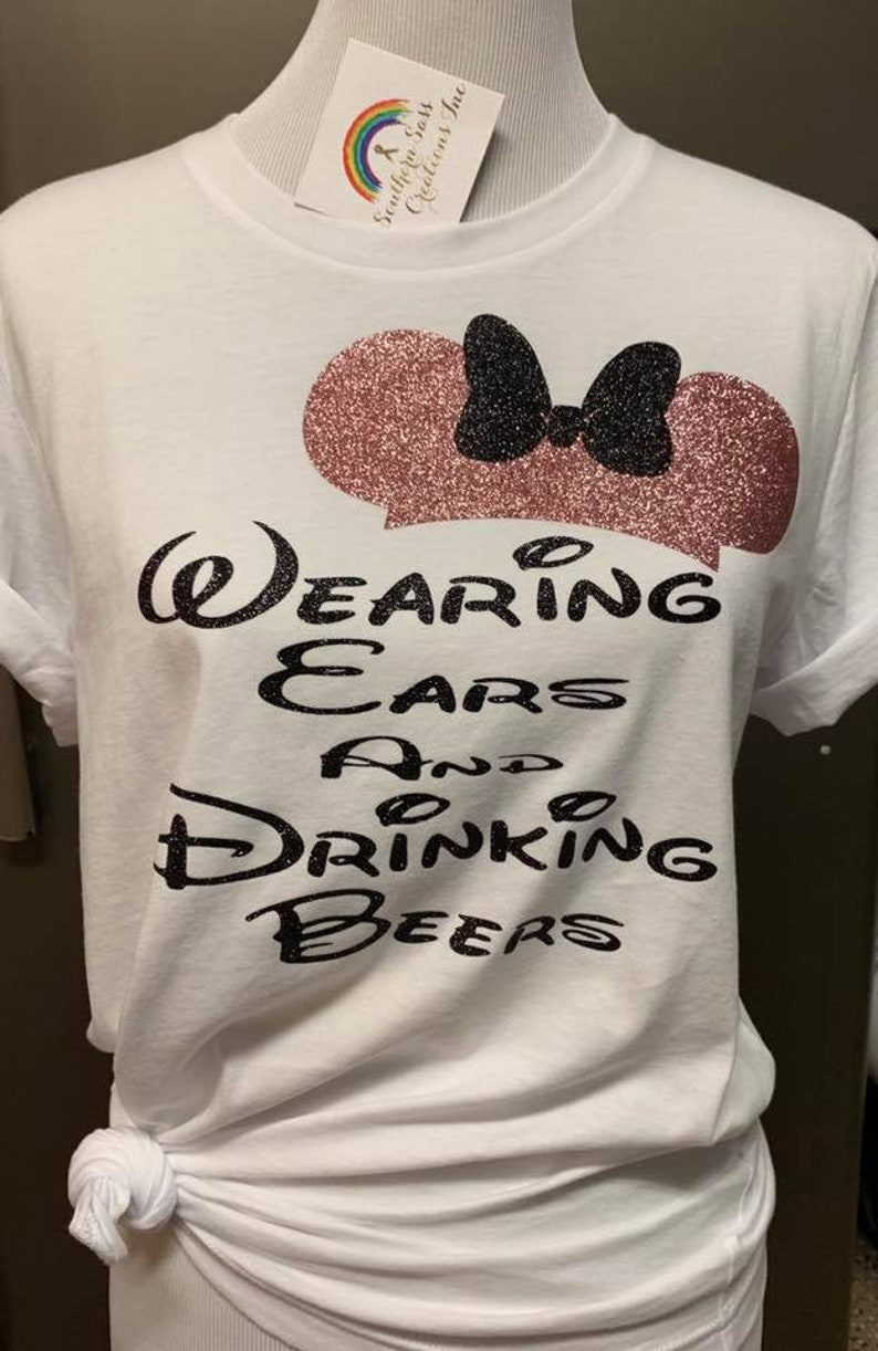 Wearing Ears and Drinking Beers Disney trip vacation Epcot image 0
