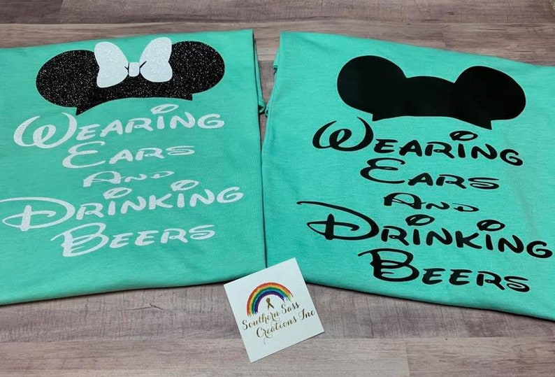 Bride and Groom Disney Wearing Ears and Drinking Beers His and image 0