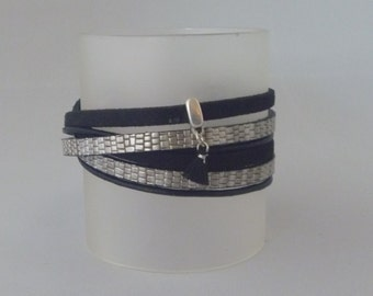 Black/silvercolored wrap bracelet with a tuft