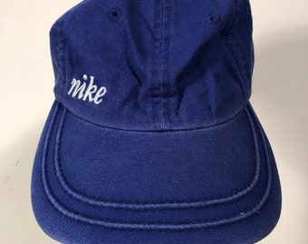 aa70dc10133 90s vintage blue nike spellout hat