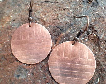 Etched copper circle earrings.