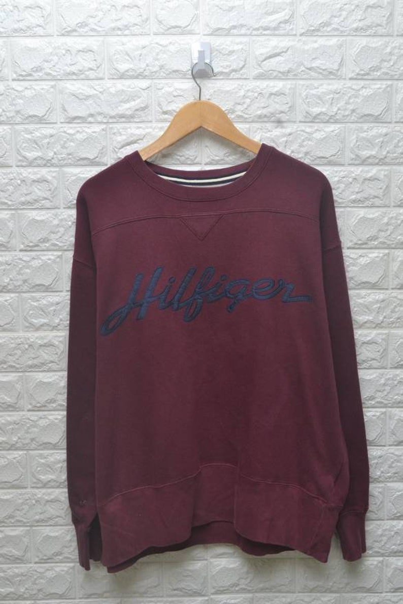 c5945883405 Vintage 90s Tommy Hilfiger crewneck logo sweatshirt   Etsy