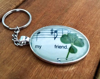 Genuine four-leaf clover keychain with Beatles Sheet music