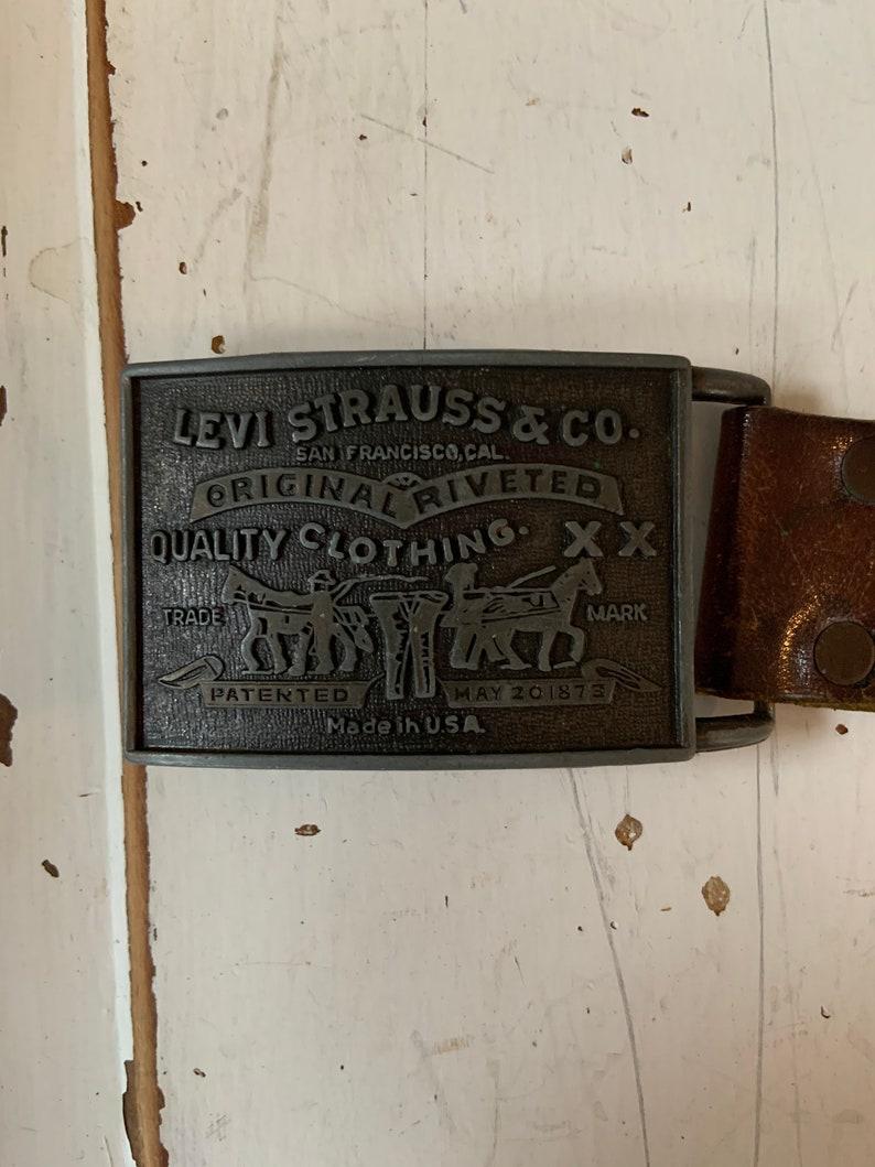 Vintage Levi\u2019s Strauss Belt Buckle and Leather Belt