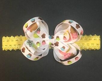 Cupcake headband bow on a stretchy yellow headband