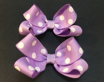 Set of two small purple bows