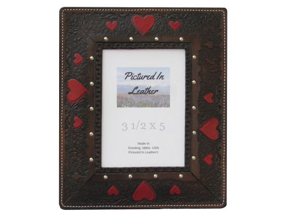 A beautiful leather picture frame, in a 3-1/2x5 size, handmade, with hand painted red hearts, great leather anniversary gift