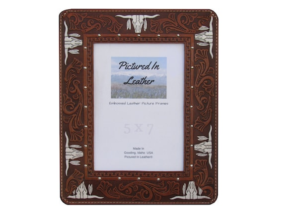 A western leather picture frame, 5x7, with an embossed longhorns design on it that we hand paint the longhorns white making it beautiful.