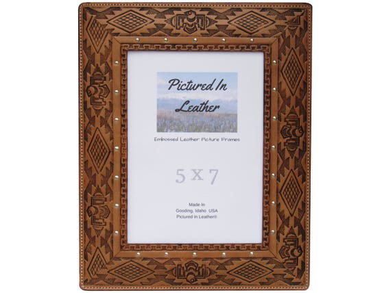 A 5x7 leather picture frame embossed with a southwest design. Light brown leather photo frame great for your southwest, desert decor.