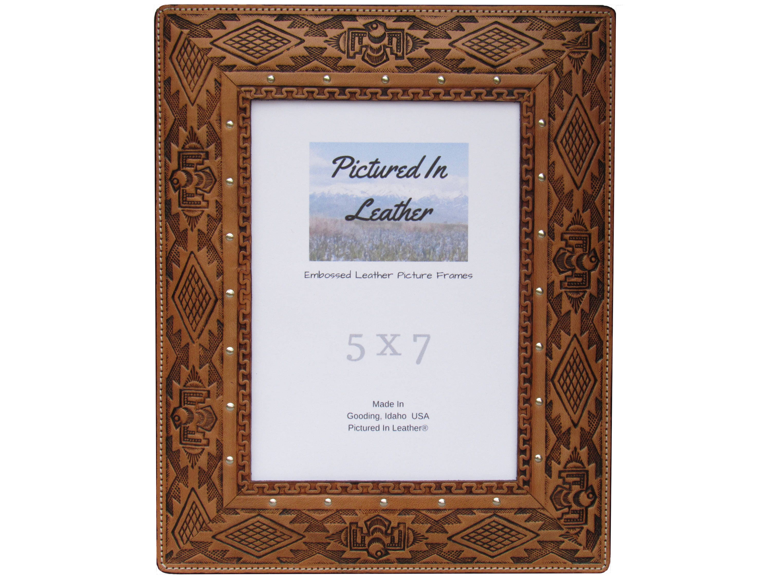 A 5x7 leather picture frame embossed with a southwest design. Light ...