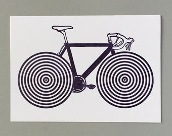 Bicycle. Spokes Illusion. Move in a circular motion and spokes will appear. Letterpress Card. Historical print. Archives. Unlock History.
