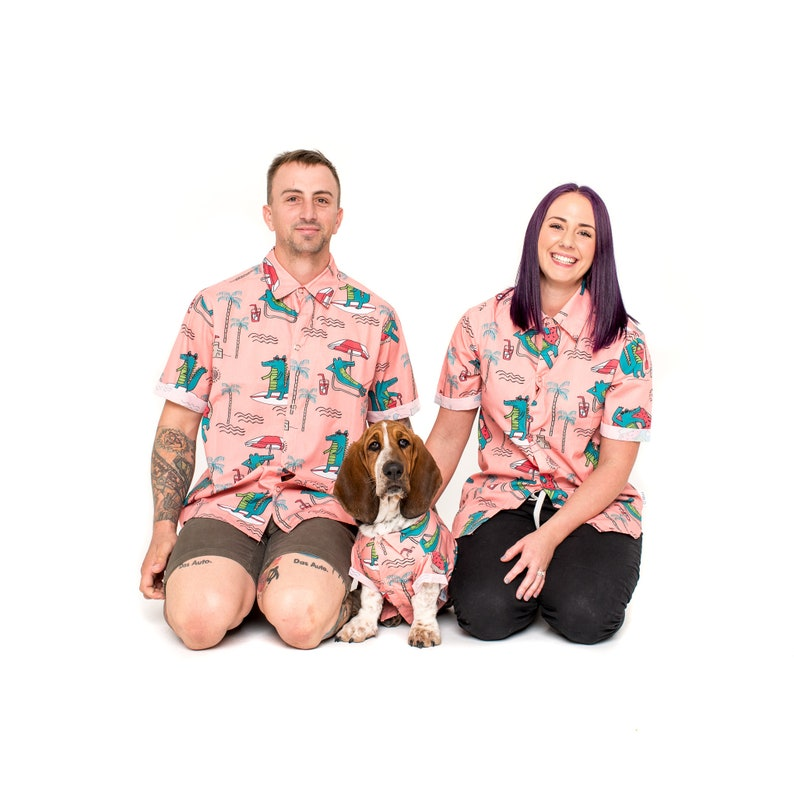 Dog and owners posing with matching shirts
