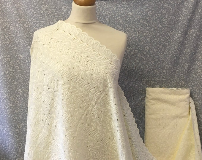 Ivory or cream embroidery anglaise, eyelet or broderie anglais cotton fabric, scalloped edges