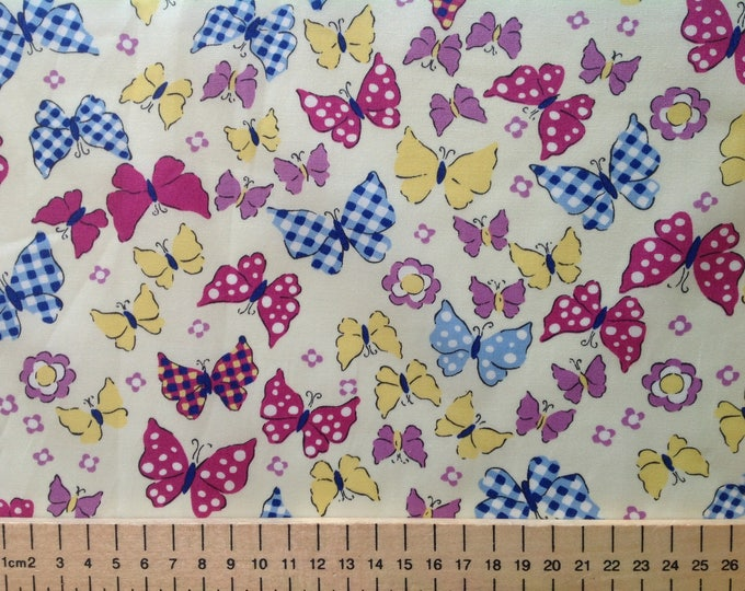High quality cotton poplin, butterflies on light yellow or cream