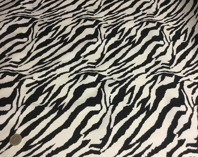 Oekotex cotton poplin with black/ivory zebra print