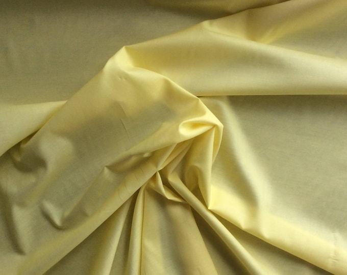 Plain cotton lawn fabric, lemon yellow