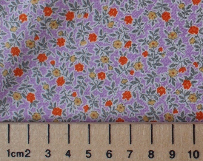 High quality cotton print, small floral on light violet print
