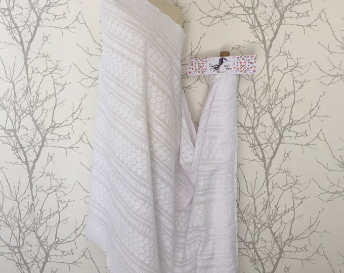 White embroidery anglaise, eyelet or broderie anglais cotton fabric, scalloped edges