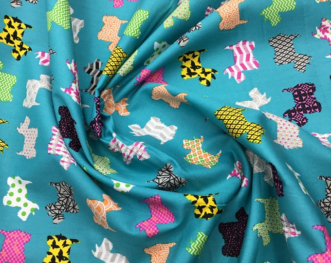 High quality cotton poplin. Fox terrier dogs on turquoise