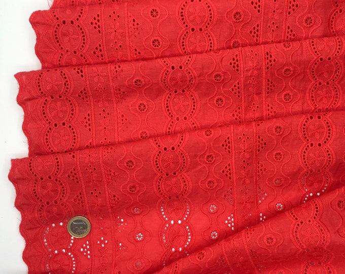Red embroidery anglaise, eyelet or broderie anglais cotton fabric, scalloped edges