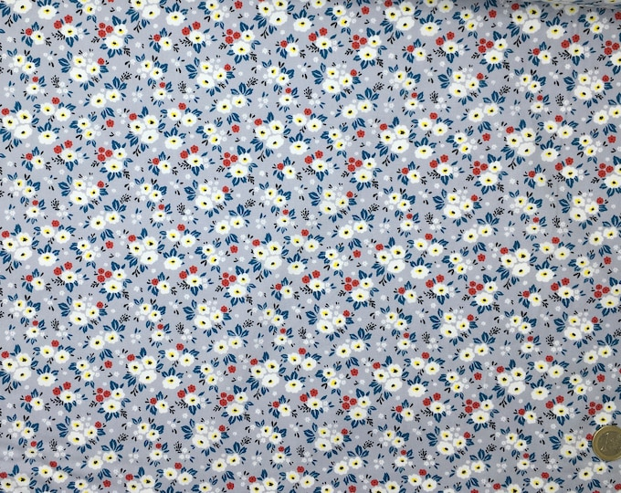 Cotton poplin with Fifties floral on silver Grey