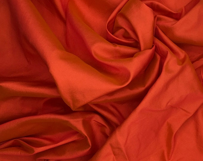 Two tone Soft, red/orange silk fabric, same thickness as sateen fabrics but less shiny