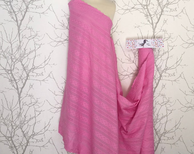 Pink embroidery anglaise, eyelet or broderie anglais cotton fabric, scalloped edges