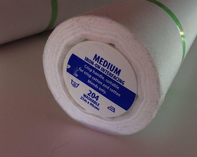 Medium, white, iron on interfacing fabric