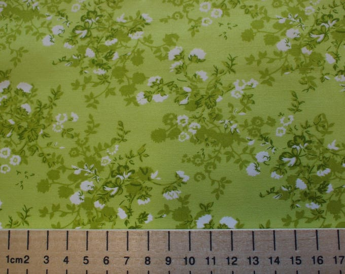 High quality cotton poplin, white floral print on apple green