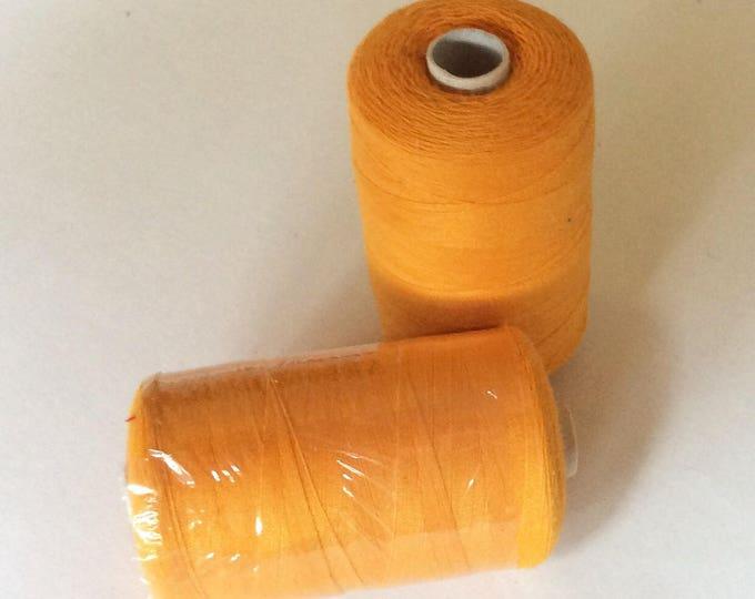 Sewing thread, 1000yds or 915m, yolk yellow