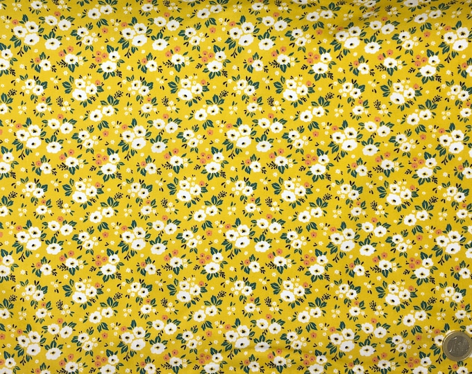 Cotton poplin with Fifties floral on curry yellow
