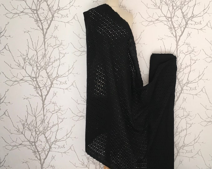 Black embroidery anglaise, eyelet or broderie anglais cotton fabric, scalloped edges