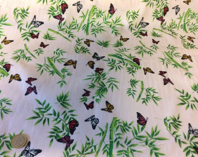 High quality cotton poplin dyed in Japan with butterflies on pink/cream