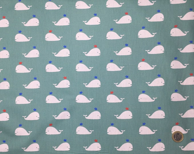 High quality cotton poplin dyed in Japan with whales on green