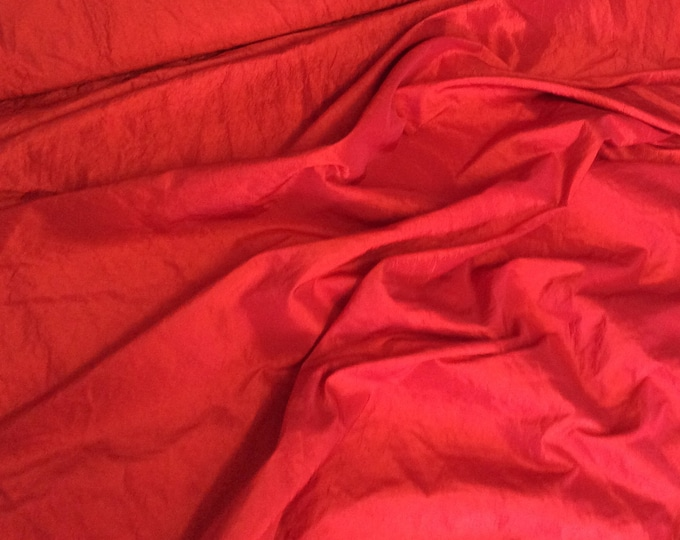 Wrinkled red taffetas fabric