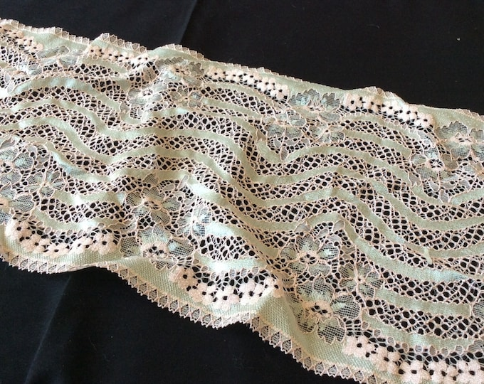 Pale pink lace fabric piece from a well known lace manufacturer